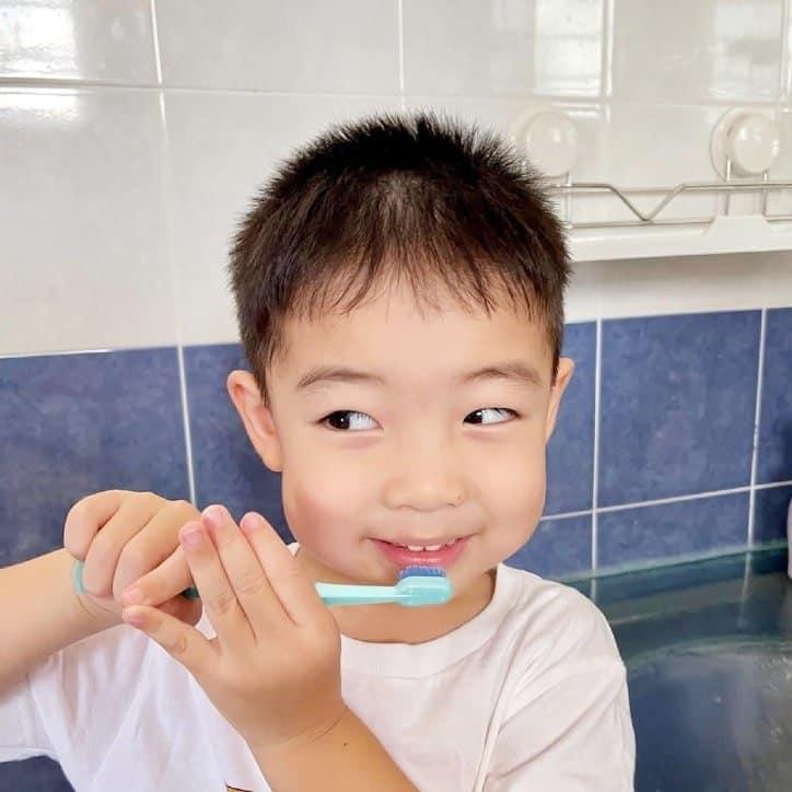 Little boy using a toothbrush